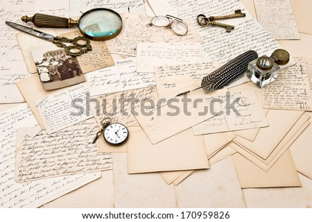 old letters, postcards, vintage accessory and photo of a family. retro style nostalgic background. collectible goods. ephemera