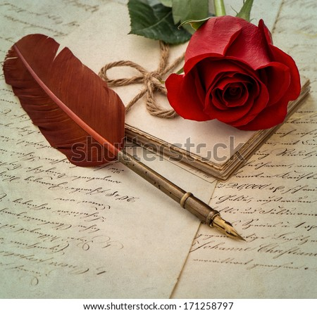 old letters, rose flower and antique feather pen. romantic vintage background. selective focus