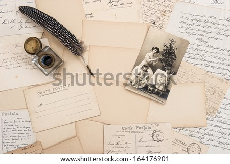 old letters, vintage postcards and antique feather pen. nostalgic sentimental background with retro christmas postcard