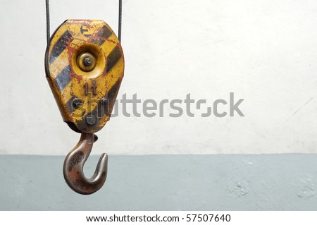 old lifting hook over obsolete wall