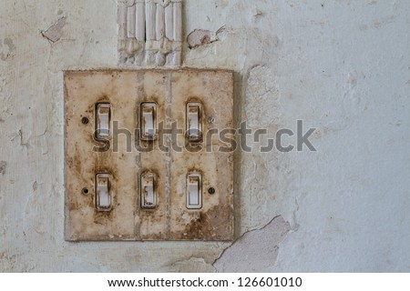 Old light switch on old wall