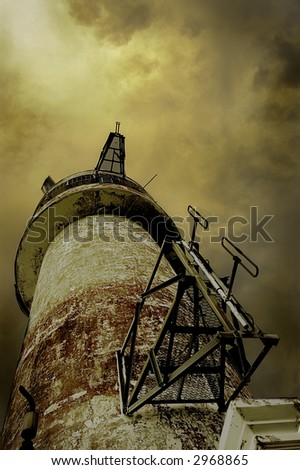 old lighthouse against stormy sky