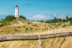 Old lighthouse Dornbusch on sunny summer day. Hiddensee, Baltic Sea.