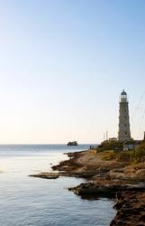 Old lighthouse, near the sunken old ship