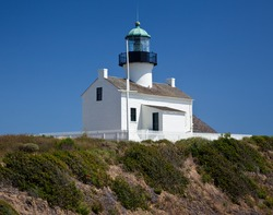 Old lighthouse on Point Loma near San Diego with a bright blue sky framing the shot