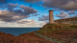Old lighthouse on the coast of Ireland. County Wicklow.