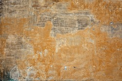 Old Lime Wash Plaster Wall With Cracked Surface Horizontal Empty Grunge Background. Yellow Brick Mortar Wall With Shabby Stucco Finishing Layer Isolated Texture. Empty Painted Jagged Rustic Wallpaper