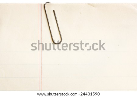 old lined paper with rusty paperclip attached