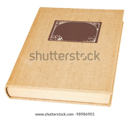 Old linen book with a brown label over a white background