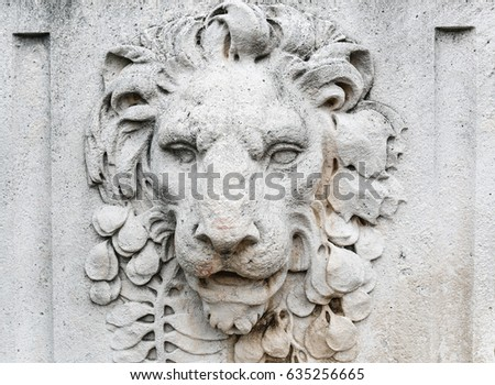 old lion head relief on the...
