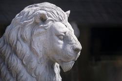 Old lion statue in garden