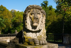 Old lion statue on a beautiful Autumn day.  Milwaukee, Wisconsin, USA