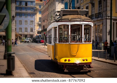 Old Lisbon yellow tram on the street. Focus on the tram