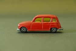 old little red toy car on a bronze background