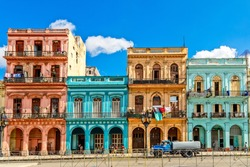 Old living colorful houses across the road in the center of Havana, Cuba