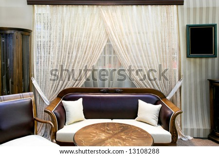Old living room with grunge furniture and curtains