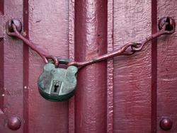 Old Lock Key on Close Red Wood Door
