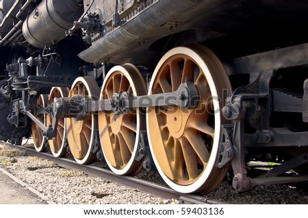 Old locomotive wheels close up. Steam train.