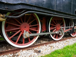 Old locomotive wheels detail close-up