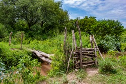 old log bridge to cross the ditch