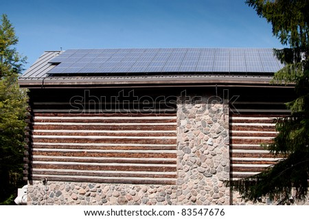 Old log building with solar roof