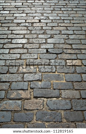 Old London cobblestone street close up.