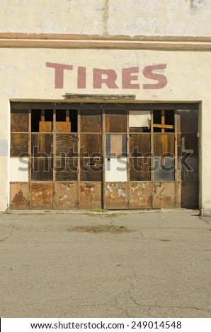 Old long closed up tire shop in a small town on an old highway in northern California