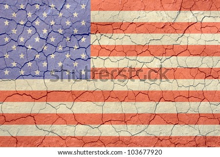 Old looking american flag with an arid cracking soil appearance. / American Flag on Cracked Soil Background / Great look, with a straightforward concept.