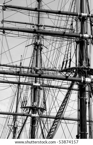 Old Looking Black and White Image of Historic Ship Masts and Rigging.