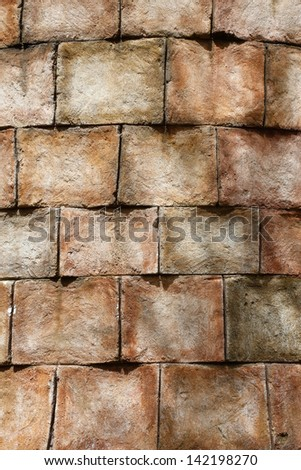 old looking brick stones or concrete wall in round building shape