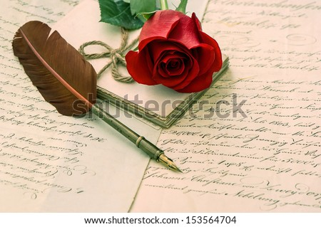 old love letters, rose flower and antique feather ink pen. romantic vintage background. selective focus