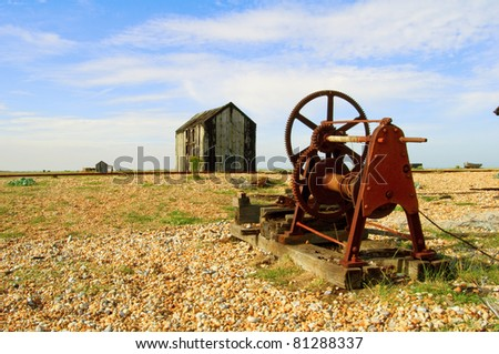 old machinery and shack on shingle