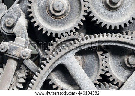 Old machinery: gear, metal cogwheels, nuts and bolts. Everything is working fine since a lot of time ago!.