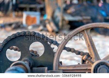 Old machinery used for hauling boats up the beach   Chain, wheel, gear Component stock photo