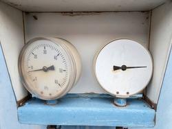 Old malfunctioning analog manometer. Manometers showing steam pressure in old steam power train engine