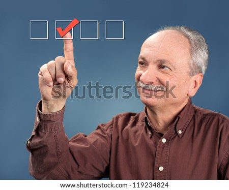 Old man choose check mark on box