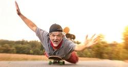 Old man crazy on skateboard