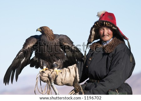 Old-man eaglehunter with golden eagle