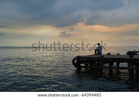 old man fishing at the dock