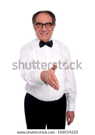 Old man in bow tie and white ceremony shirt offering handshake