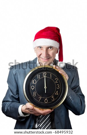 Old man in Christmas hat holding a big clock isolated on white