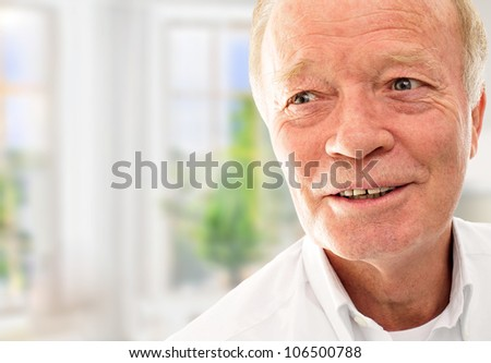 Old man is very happy with his new apartment in modern building. New apartment for old people concept