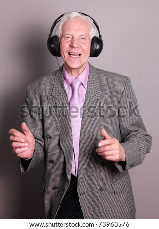 Old man listens music and dance