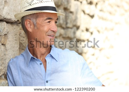 Old man looking away - stock photo