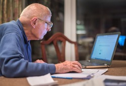 Old man of 93 years having trouble using his computer to check his finances online,very challenging for old people.