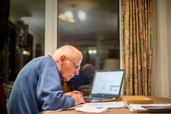 Old man of 93 years having trouble using his computer to check his share values online,very challenging for old people.