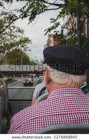 Old man on a tour bus. #1276868845