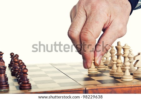 old man playing chess isolated on a white background