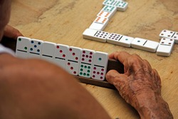 Old man playing domino in Trinidad