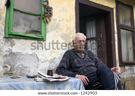 old man sitting and smoking